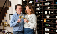 Eugenio Meschini and Teresa Thein Meschini, co-owners of Famiglia Meschini winery, enjoy a glass of their creation.