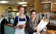 Head baker Anne Andrus, left, with friend and co-worker of Honey and Rye Bakehouse, Emily Ackerman.