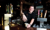 Chad Soland pouring one of his signature drinks, the Irish Headlock.