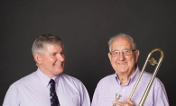 Steve Lyons, director of the St. Louis Park Community Band, left, and Al Sweet, enjoy making music.