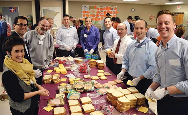 Volunteers making sandwiches for the 363 Days Food Program.