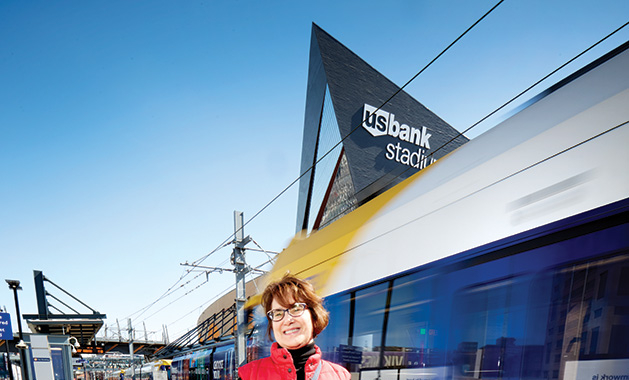 TC Trainspotting blogger Lisa Hoff stands at the US Bank Stadium stop of the light rail.