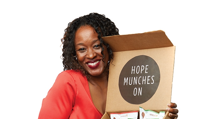 Junita Flowers, the founder of domestic violence support and awareness group Junita's Jar, holds a box of cookies.