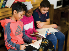 Three students reading.