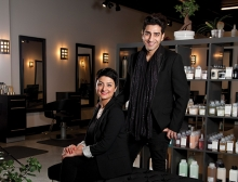 Revolution Salon co-founders Sasha Zoghi and Saeid Homayouni pose in the salon.