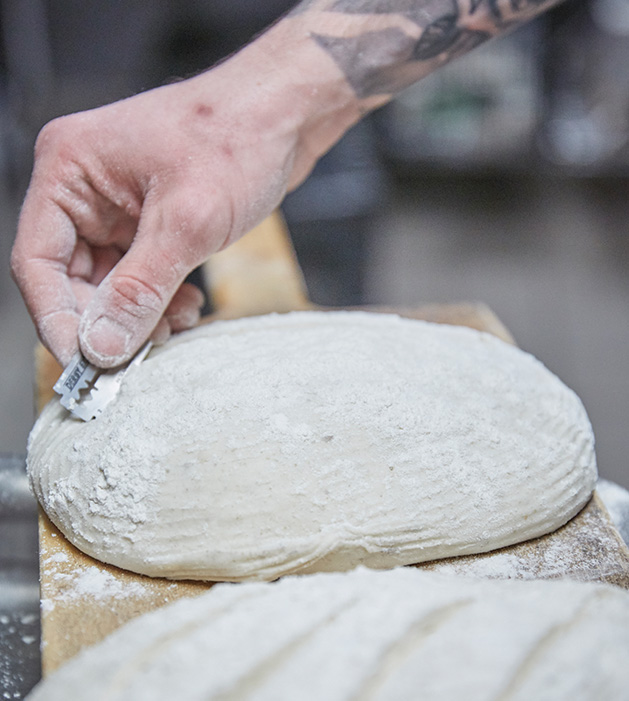 Christopher Sarles works with dough from Lowertown Bakehouse